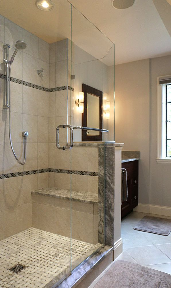 Frameless glass enclosures allow small bathrooms to feature a large ...