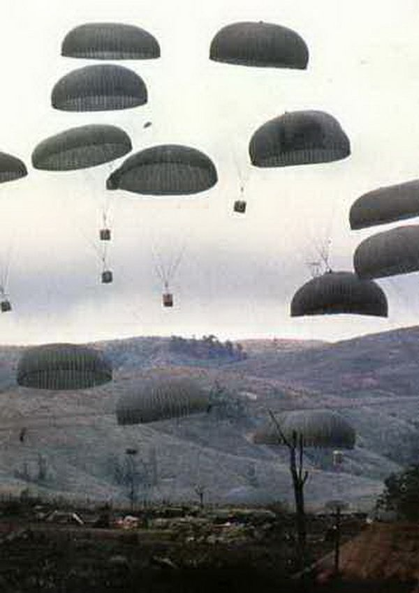 Food and weapons drop by parachute to Marines at the besieged Khe Sanh base in northwestern South Vietnam, March 1968. With an estimated 15,000 NVA regulars surrounding the base, Khe Sanh could be resupplied only by air.