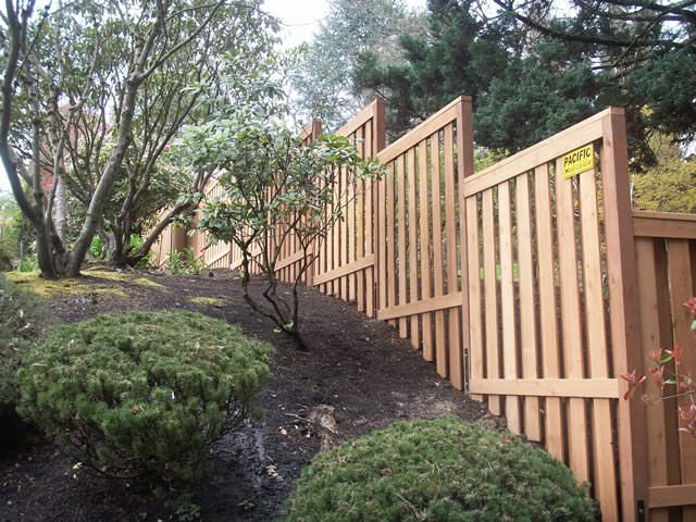 Wood Fence Installation On A Hill Back Yard Ideas