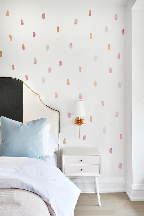 A Wall Covered In Pastel Colored Paint Swatch Wallpaper Is Lit By A Worlds Away Delilah Sconce Mount Girls Blue Bedroom Blue Wallpaper Bedroom Little Girl Beds