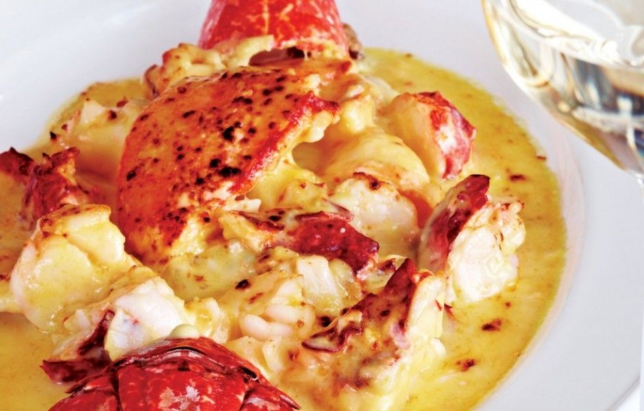 Lobster Thermidor Recipe - 4 lobsters each 450/600g cooked 55g butter 55g flour 500ml milk 1 teaspoon brandy 55g grated cheddar cheese 1 teaspoon English mustard 55ml double cream 55g grated parmesan 2 lemons halved and wrapped in muslin (if you want to be fancy)