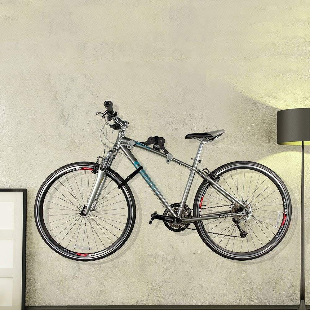 10 Creative Ways To Hang Up Your Bike Brit Co Indoor Bike Storage Bike Storage Bike Wall Mount