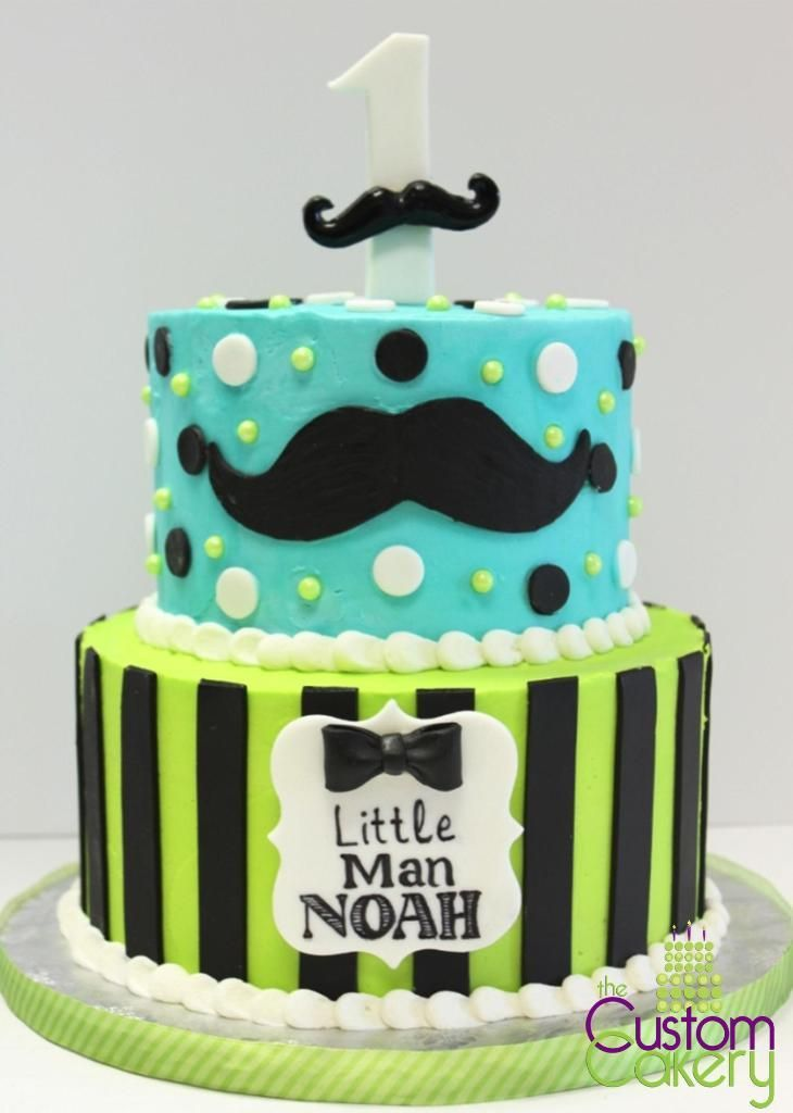 First Birthday-Little Man Mustache cake. We love the bright chartreuse and teal colors with the black and white of this cake. Cake is covered in buttercream with fondant and the plaque is hand drawn. #thecustomcakery