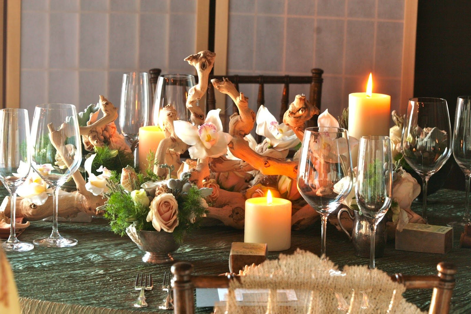 Driftwood plus flowers for centerpieces, cuts down on flower costs