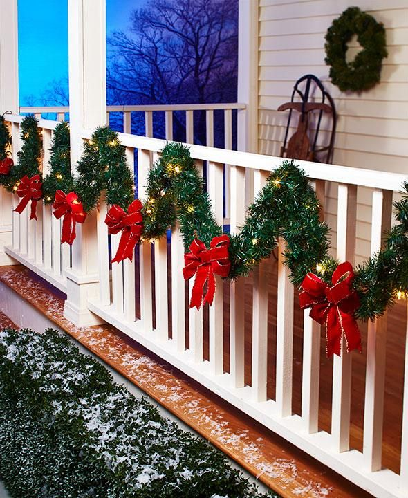 deck the halls or your porch with this 120 lit porch garland the classic lighted trim is filled with 35 lights and 3 red bows to accent a banister