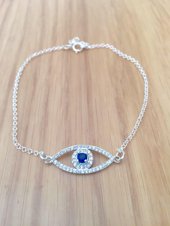 A personal favorite from my Etsy shop https://www.etsy.com/il-en/listing/459805998/silver-cubic-zirconia-evil-eye-bracelet