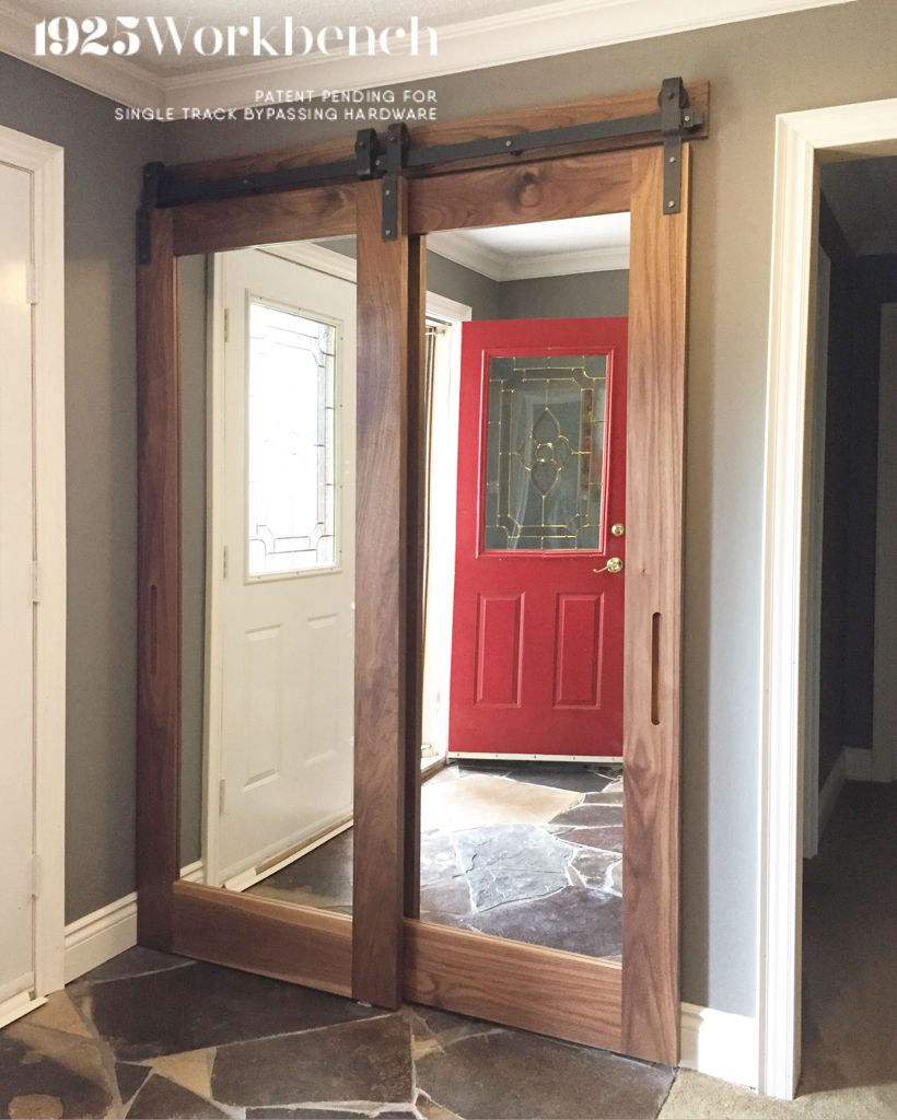 Walnut framed mirrors doors in our single track bypassing hardware ...