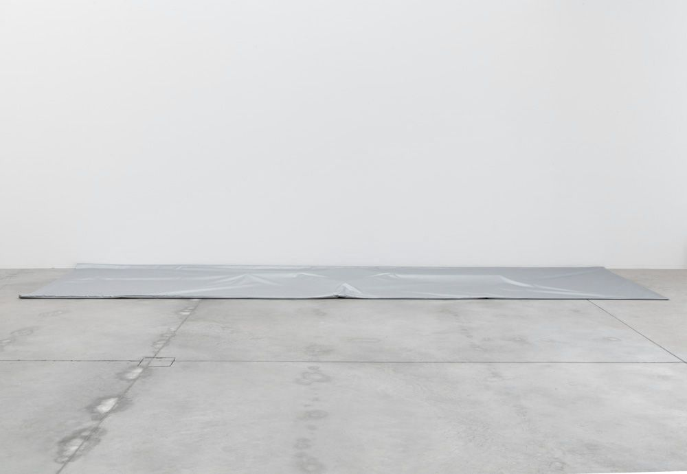 Jason Dodge - Silver tarps that cover a part of the floor, 2014