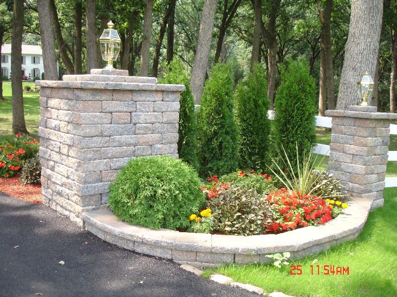Driveways long pretty driveway entrance pillars for Garden entrance ideas