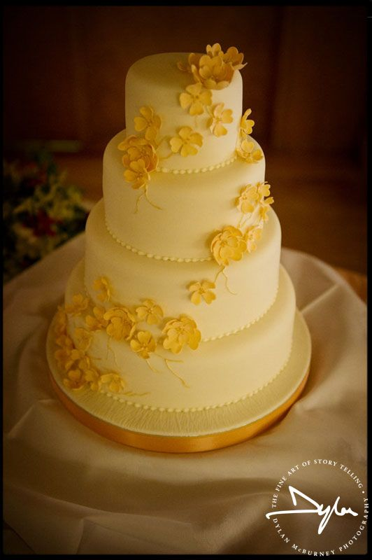 yellow flowers on this wedding cake #weddingcake | Wedding venues ...