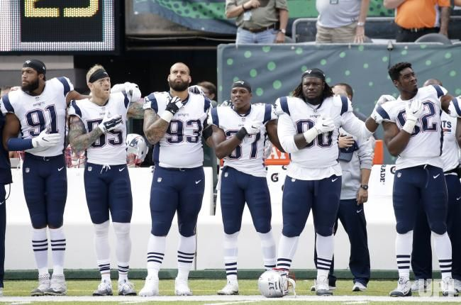 New England Patriots Players Put Their Hands On Their Hearts For The National Anthem Before The Game Against The New England Patriots Players Players Patriots