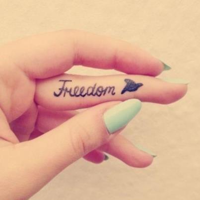 Freedom Word Inside Of Finger Bird Tattoo
