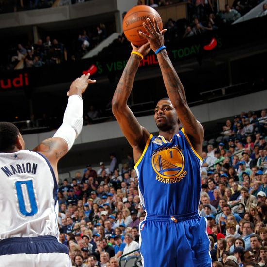 Golden State's Dorrell Wright puts up a shot over Dallas' Shawn Marion during the first half.