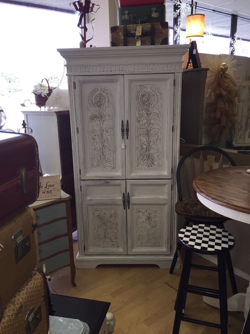 Snow White Distressed Armoire With Basil Inside.
