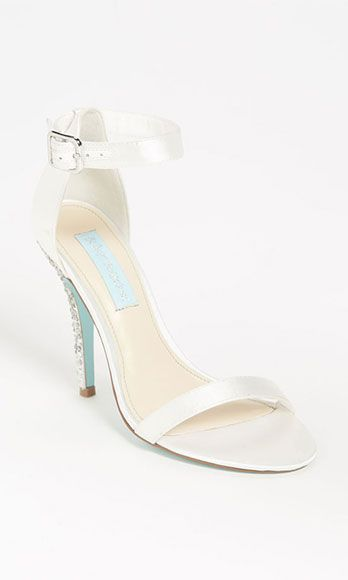 0c4833e65b76 Glitter-encrusted heels and Tiffany blue soles are a fun twist on the  standard white wedding shoe. Blue by Betsey Johnson Bells Sandal