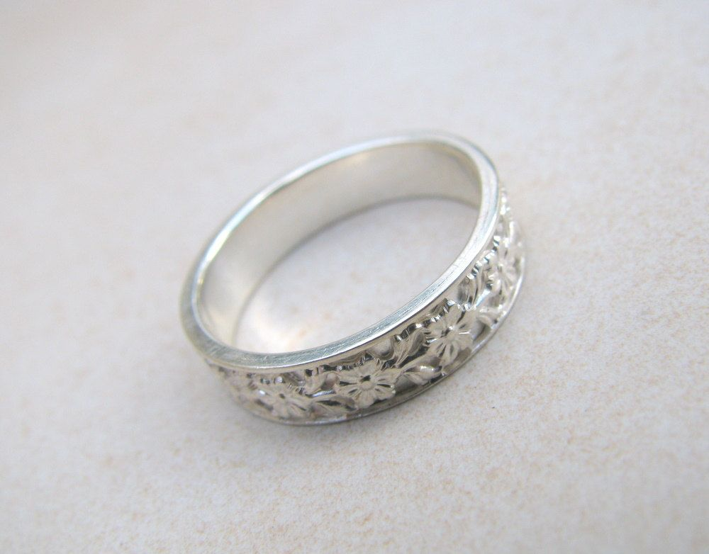 Summer wedding - Flower ring, sterling silver ring, wedding band, delicate ring, unisex wedding ring, engagement ring. $90.00, via Etsy.