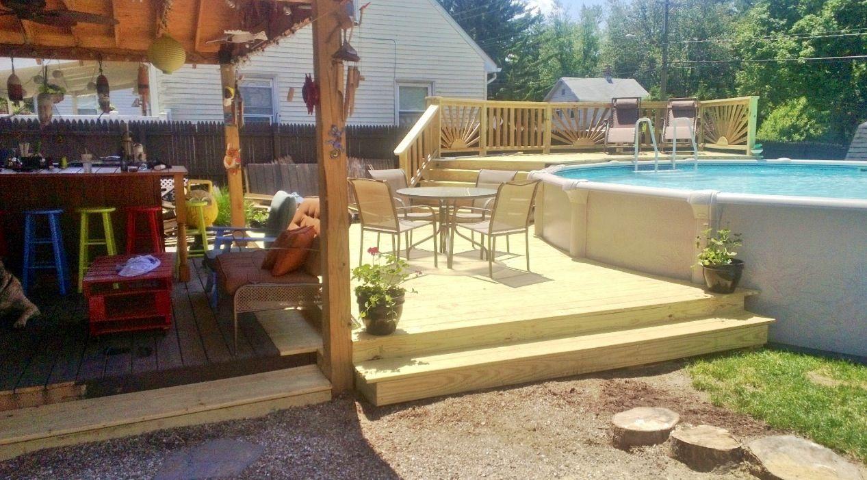 Above ground pool deck. Tiki bar. Sunburst railing. Deck ...