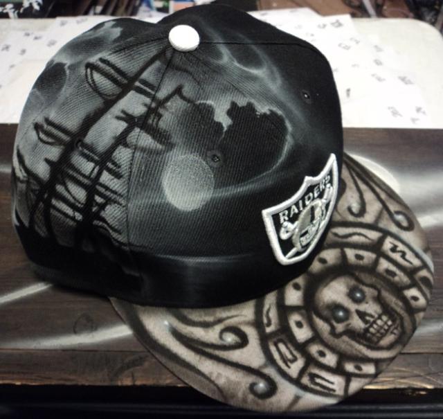 Oakland Raiders Airbrushed Leather Strapback Hat Skulls UB ...