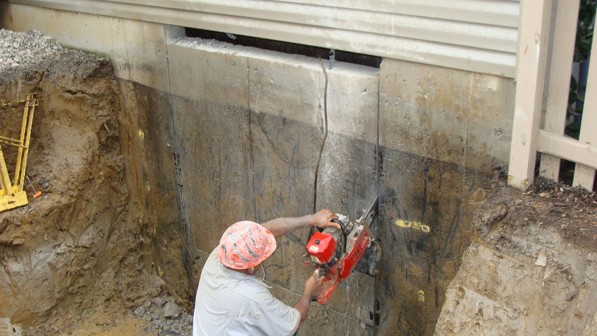 In The Trenches Foundation Builders Llc Cutting Into The