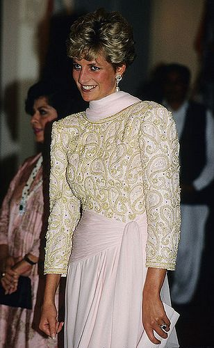 Lot 9.  Catherine Walker sarong-style evening dress.  Bodice is embroidered allover paisley design in simulated pears, gold gass beads & paste w/ a low V-shaped back. The skirt is draped to resemble a sarong from   a wide asymmetrical sash from waist to hip. Diana wore on official visit to Pakistan 1991 and for an official portrait by Snowdon.  Raised $51,750