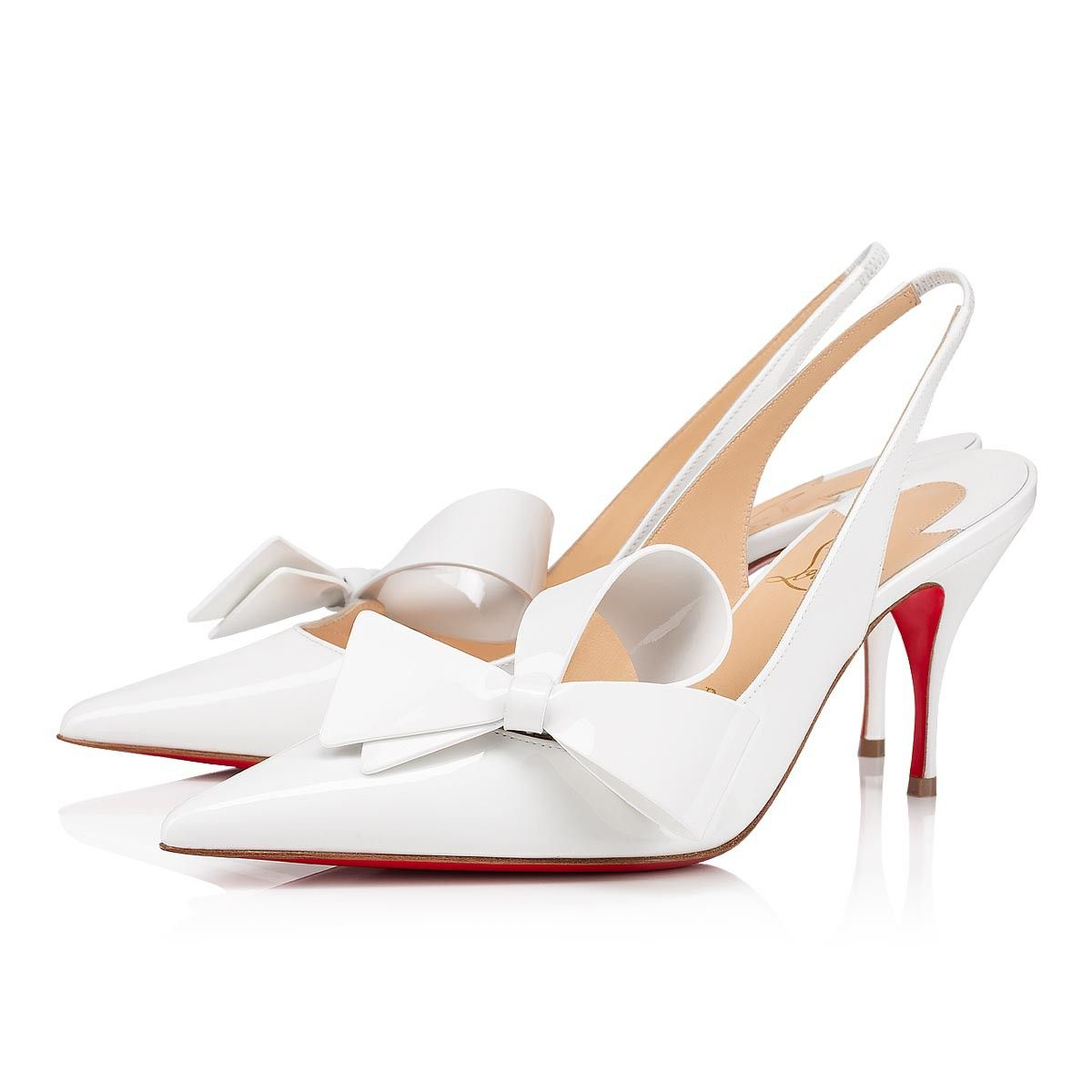 pump. Crafted in white patent leather