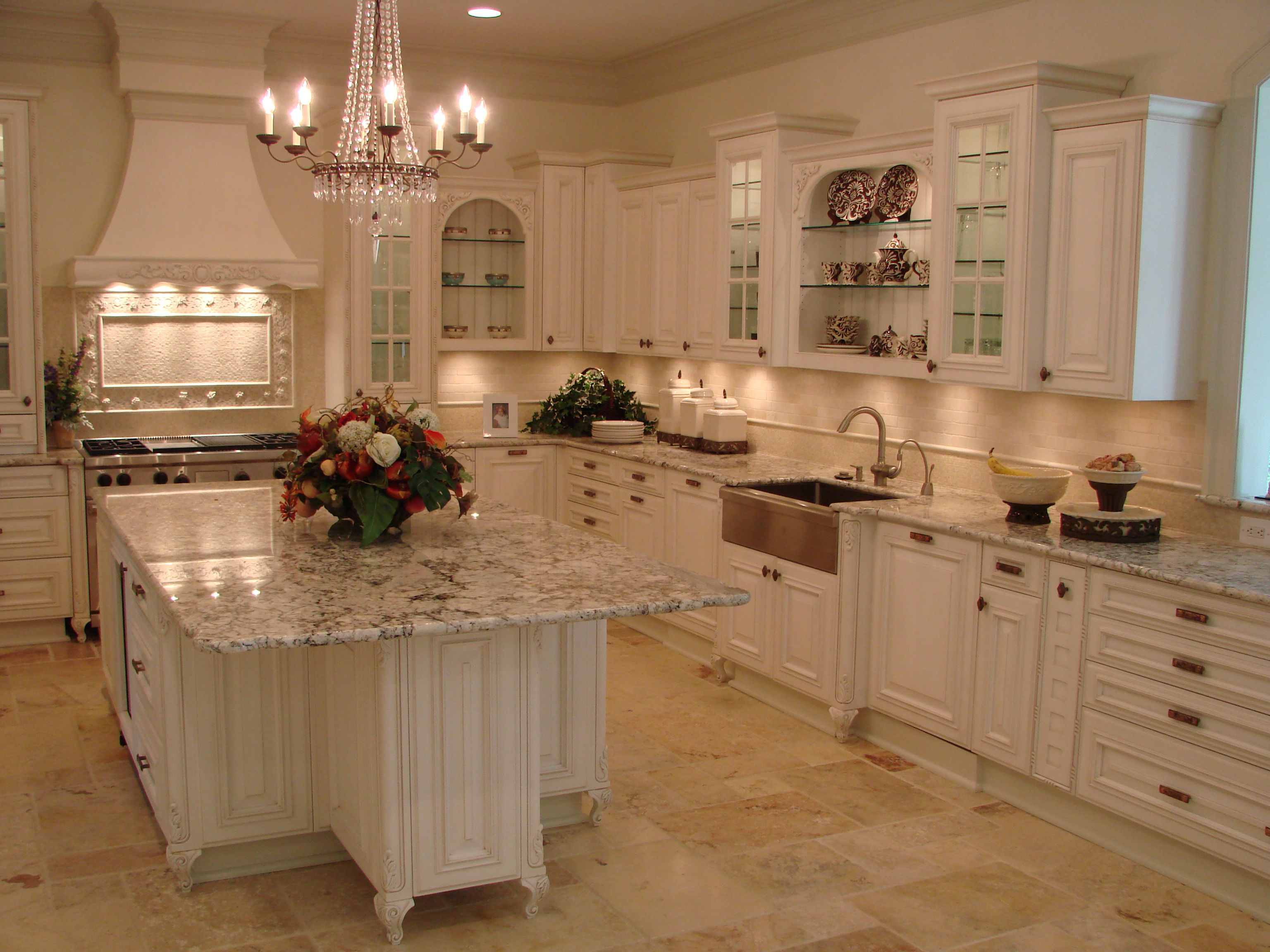 traditional kitchen design with white cabinets and marble ...