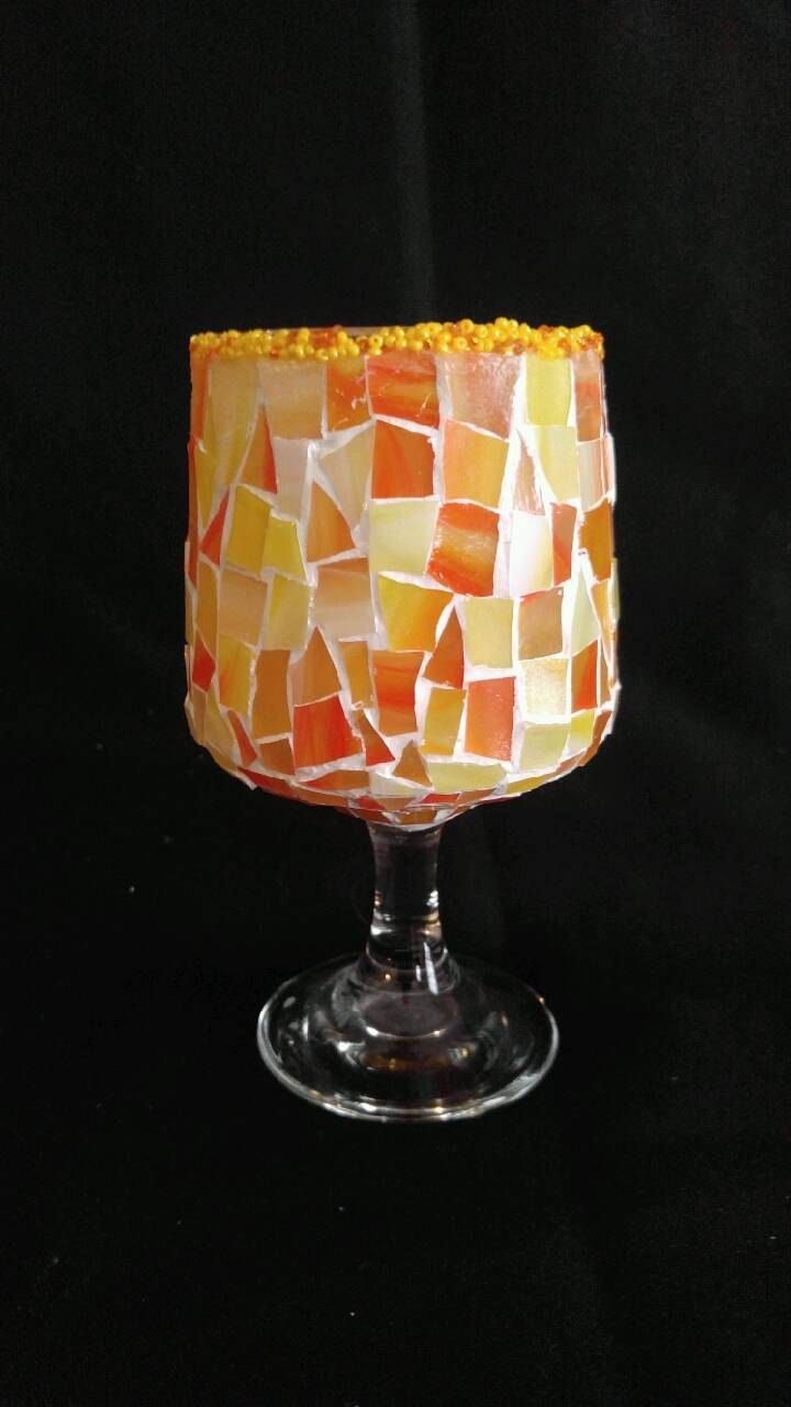 Handcrafted stained glass mosaic stemmed candle holder in shades of