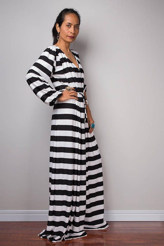 7af6f2cbce00 This stunning black and white striped long sleeved jumpsuit dress is  definitely a joy to wear