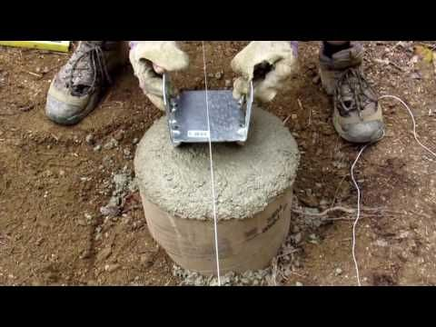 Adding bracket on concrete footer - Finishing sonotube with