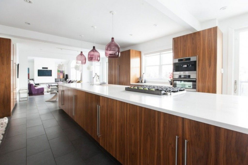 Interior Modern Kitchen Island With White Solid Surface And Walnut Cabinets Also Lung Light Shade