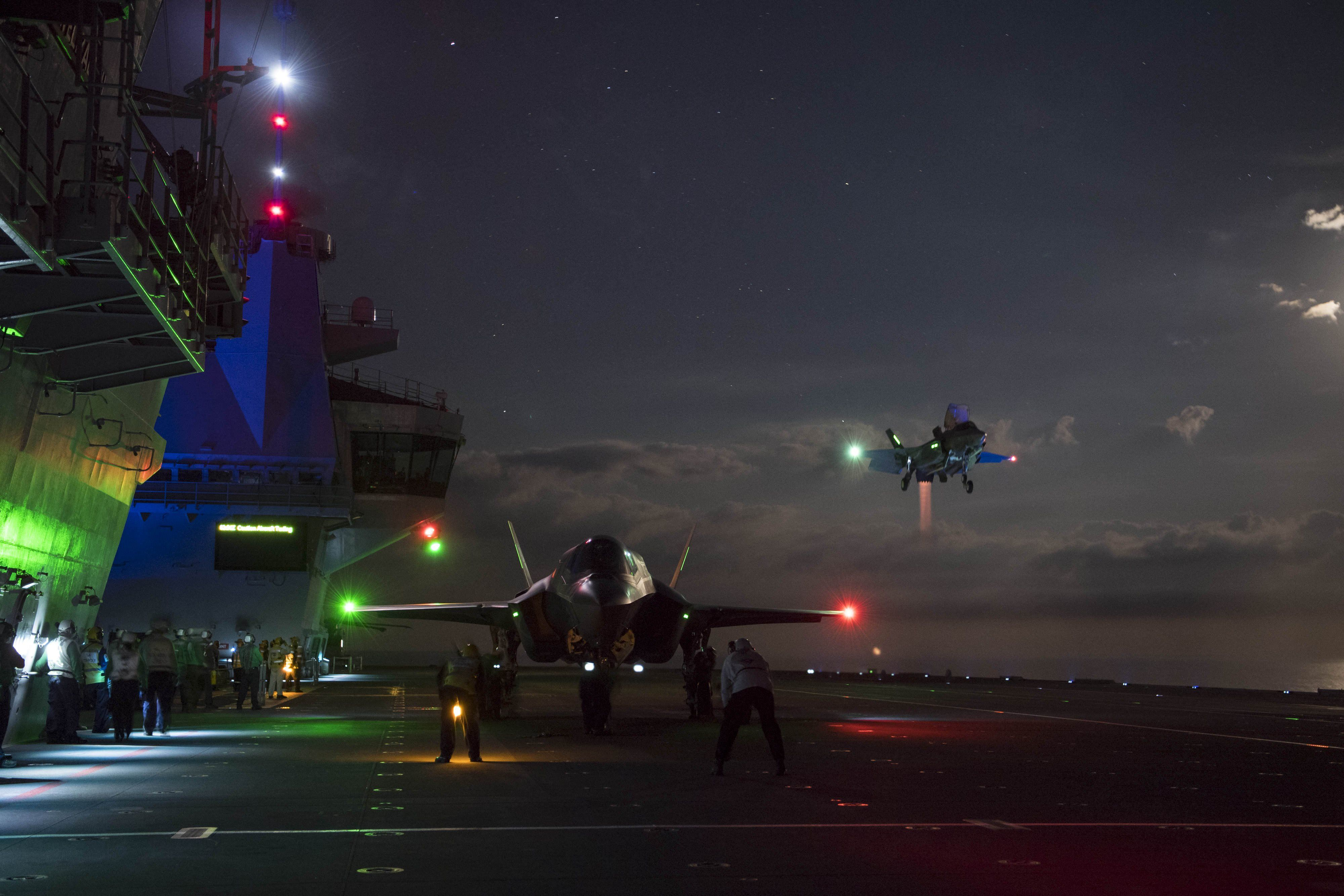 Two F35Bs landing on the deck of HMS Queen Elizabeth at