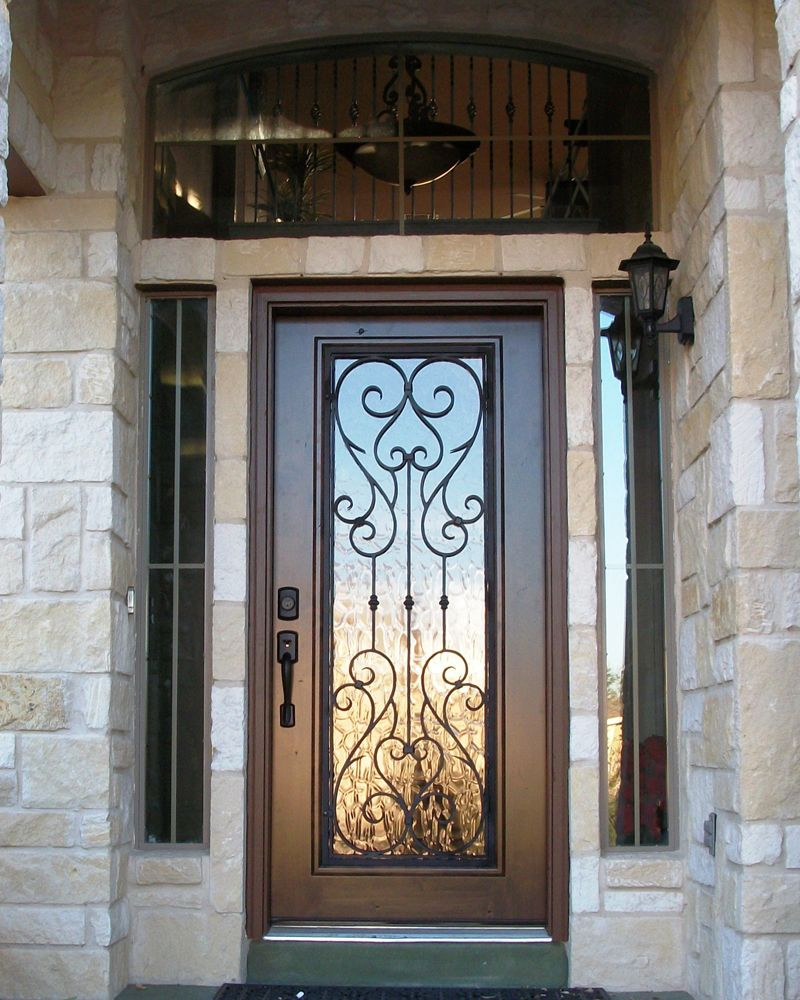 Wood and wrought iron door with transom front door entry for Wrought iron entry doors