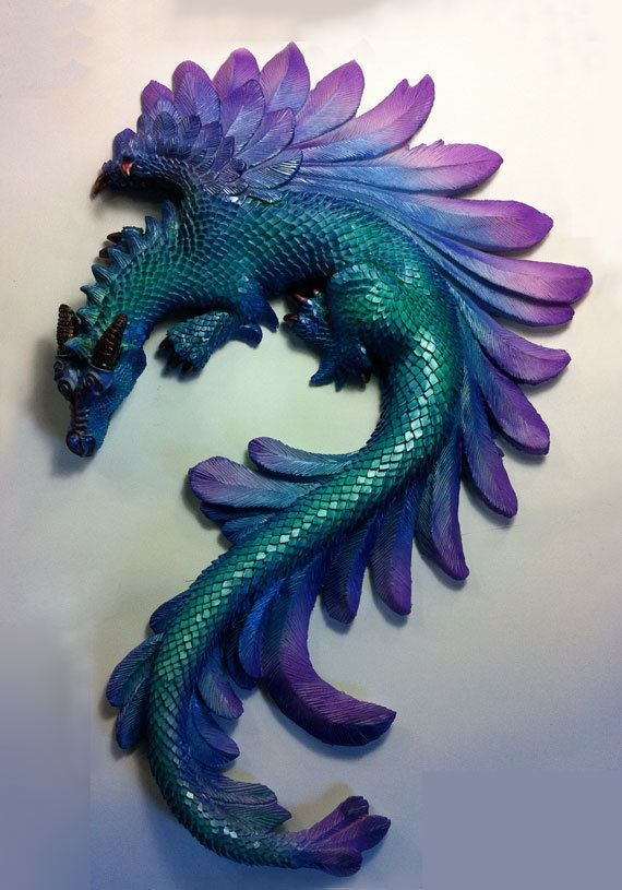 This is Thorn, the Dragon, a resin cast of an original sculpture by me. He is hand painted by myself. Size is 12.5 x 8.5 and is designed as a