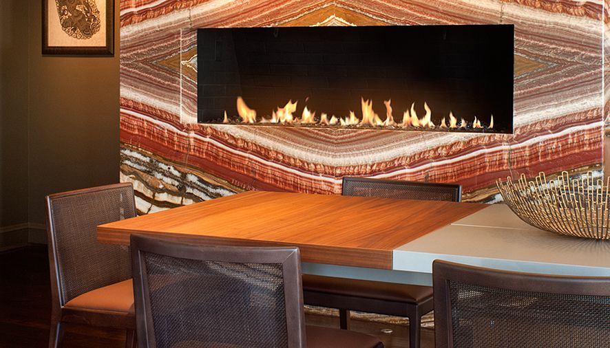 Fireplace embedded inside beautiful red granite