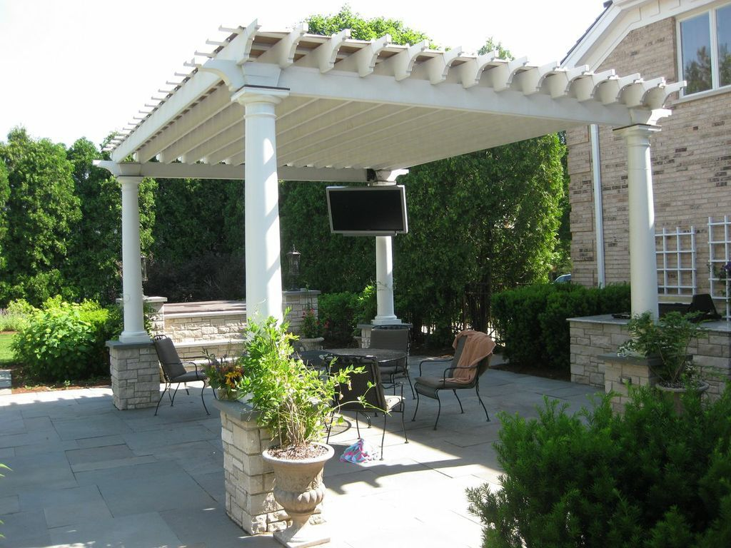 the expansive patio area includes a built in bbq custom pergola with a tv hot tub fire pit and pondless waterfall