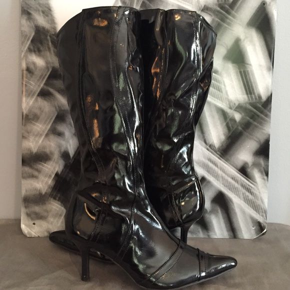 """Knee High Patent Boots! Boots have several seams going up the leg for a nice detail. They also dip down just a little at the top in the back for another added design. Comfortable heel height,  only about 2-1/2 """". Worn a few times but still in great condition . Dollhouse Shoes"""