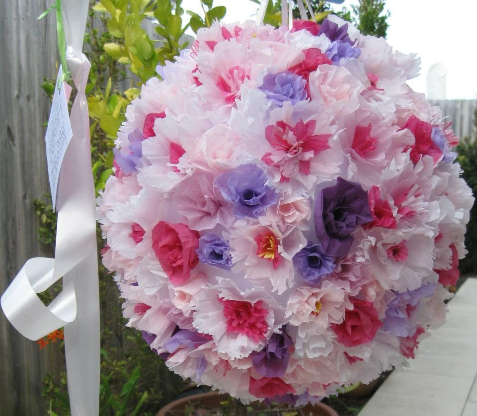 Lots of tissue paper flowers on the wedding flowerball ...