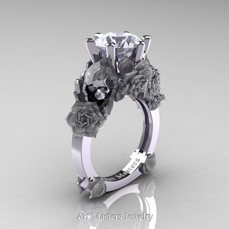 Extraordinary beautiful and elaborately symbolic, this exclusive Love and Sorrow 14K White Gold 3.0 Ct Russian Ice Simulated Diamond Skull and Rose Solitaire Engagement Ring R713-14KWGRICZ by Art Masters Jewelry evokes genuine character and design elegance is sure to please the most discriminating taste. Includes: * 1 x over 8.0 grams TW (approx) of cast solid 14K white gold setting (official gold stamp) * 1 x round 3.0 carat (approx) euro diamond cut Russian ice simulated diamond cubic zirconia