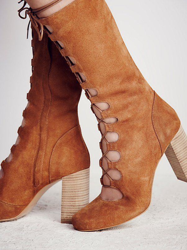 Carly Lace Up Heel Boot   Lace-up boots featuring a classic silhouette with a rounded toe and stacked heel. Hidden side zip for an easy on/off.