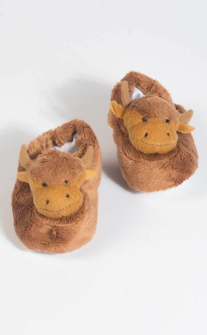 Highland Cow Bootees by Scotweb Originals  These adorable cow bootees are the perfect way to add a touch of Scotland to your little one's wardrobe.