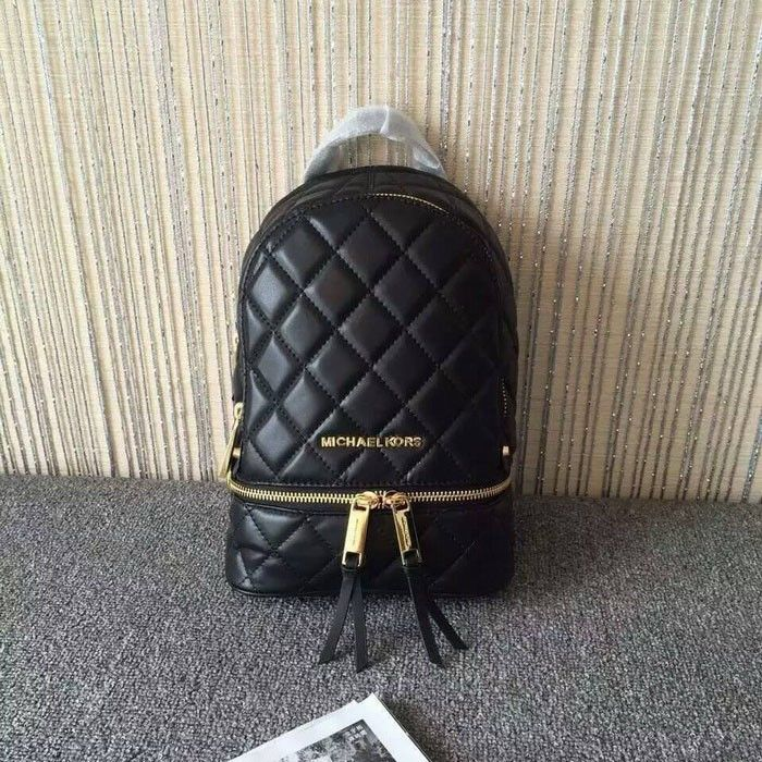 044386591ae3e MICHAEL Michael Kors Rhea Extra-Small Quilted-Leather Backpack Black ...