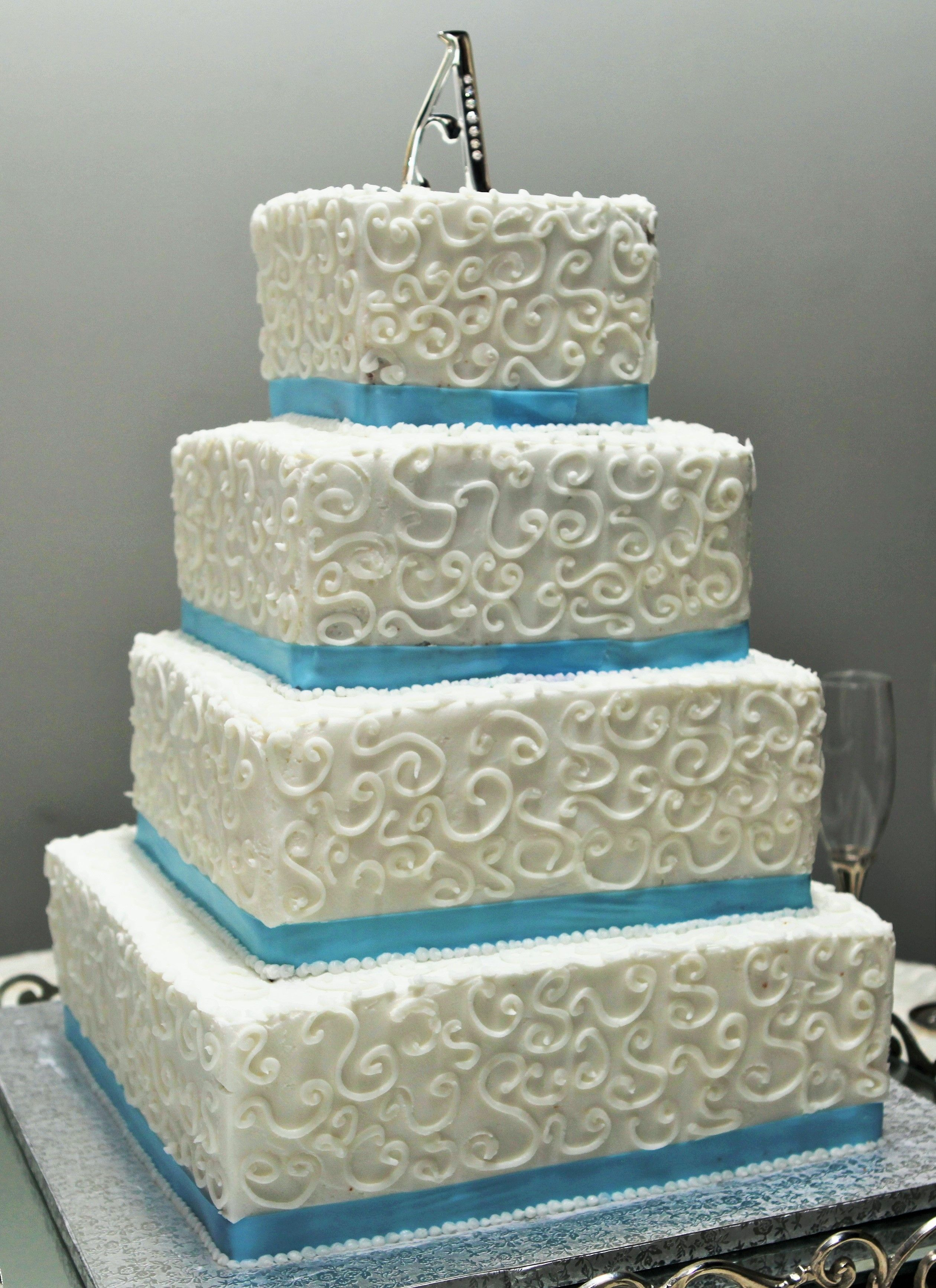 4 tier wedding cake square 4 tier square wedding cake with swirl design blue ribbon 10408