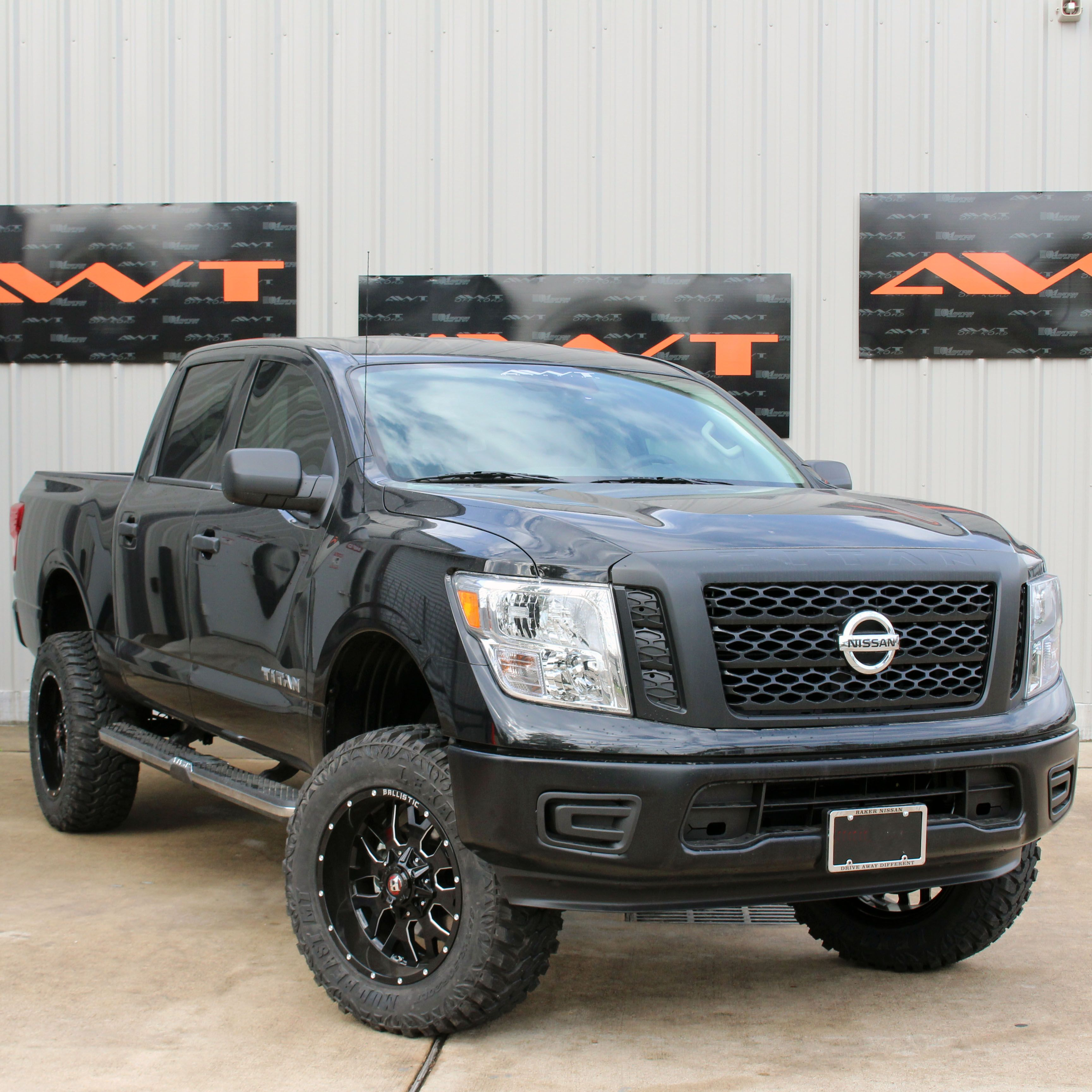6 Rough Country Lifted Nissan Titan Rolling On 20 Ballistic Offroad Wheels Tank Wrapped In 35 Lexani Tires N Nissan Titan Truck Nissan Titan Nissan Trucks