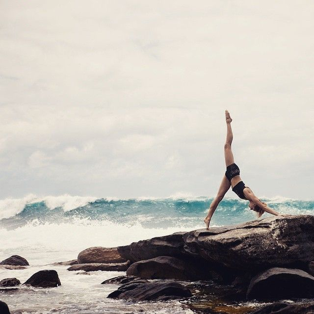 Yoga with the stormy ocean. Cause we're the daughters of the seven seas. Yoga poses + yoga inspiration + yoga motivation