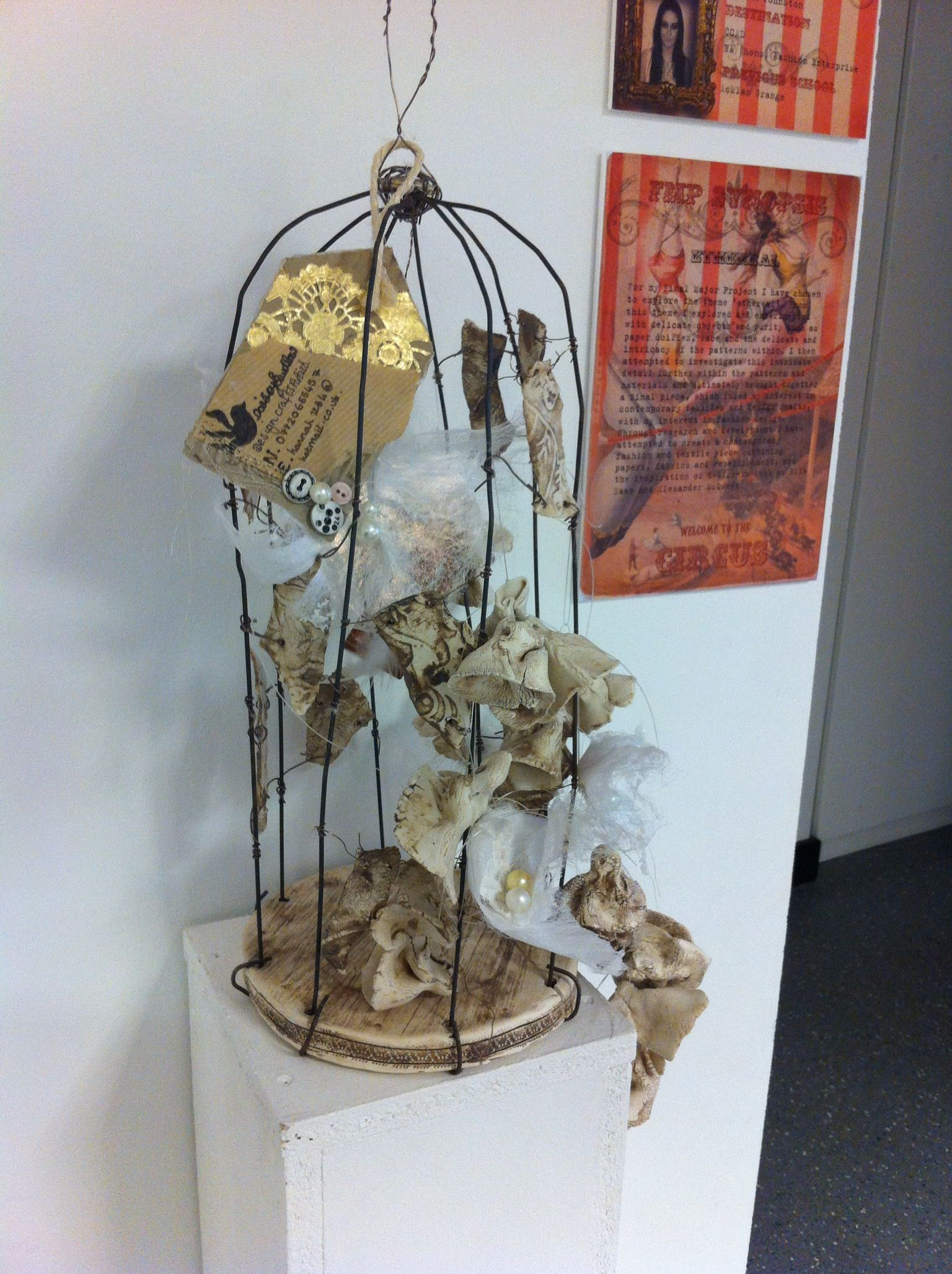 Mixed media metal birdcage, with ceramic and fabric flowers...created by graduating second year student Hannah Johnston