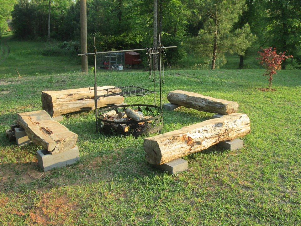 I love these log seats by a fire pit. I want to cook ...