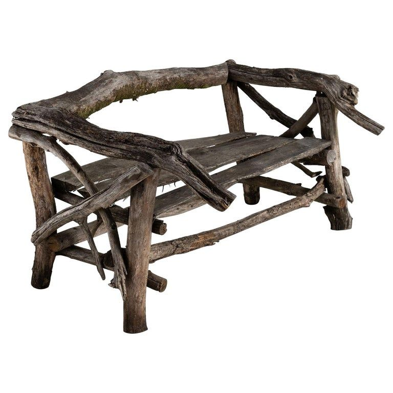 Handmade Tree Branch Garden Bench, France circa 1940. Weathered garden bench constructed of branches, with three plank seat.