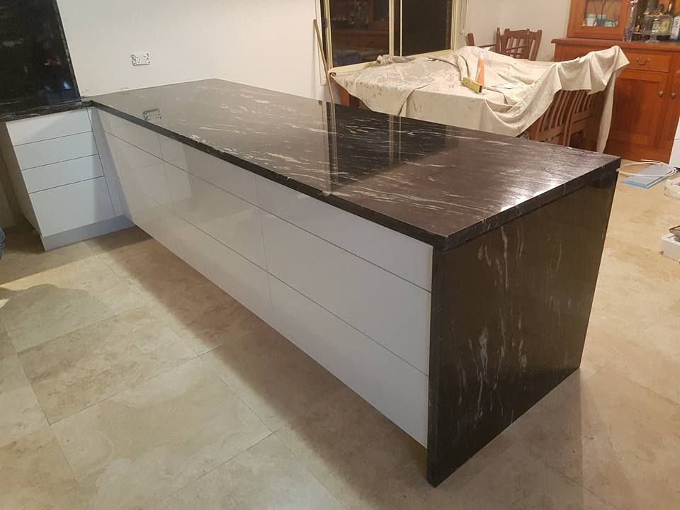 40mm Cosmic Black Granite Kitchen Bench Top With Shadowline Waterfall And  Splashbacks. Granite From WK Quantum Quartz.