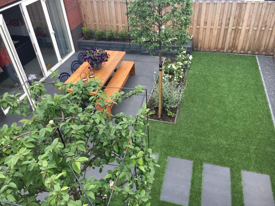 Tuin En Kunstgras : Kindvriendelijke tuin met kunstgras en grote tegels