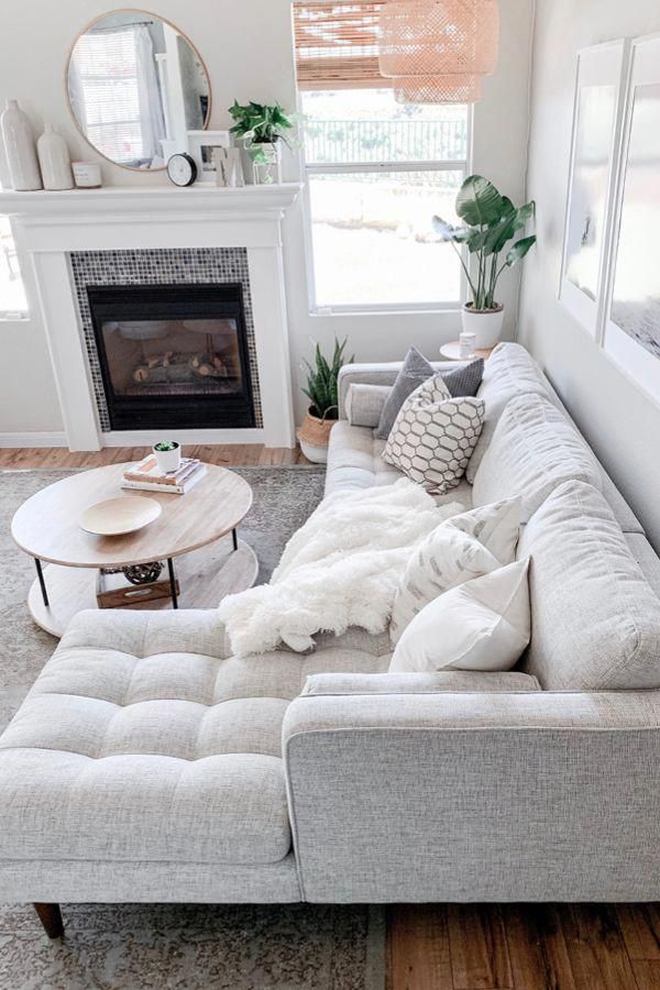 Make an all white space work by mixing in different patterns and textures. Photo by Domestic Blonde. #Sofa #MCMSofa #MidCenturyModern #livingroom #cozyliving